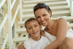 Mother with her son on stairs Stock Image