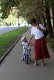 Mother with her son walking in the park Royalty Free Stock Photo