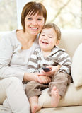 Mother and her son are watching tv Royalty Free Stock Photography