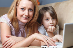 Mother with her son work on netbook computer Stock Photo