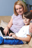 Mother with her son work on two netbook computers Royalty Free Stock Photo