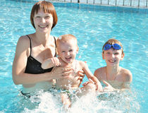 Mother with her sons in the pool Stock Photo