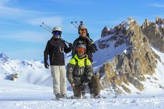 Mother and her sons, snowboard and skis. Malargue - Mendoza - Argentina - JULY - 27 - 2016. Family on winter vacations, mom, and sons enjoying an amazing sunny stock photos
