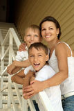 Mother with her sons on stairs Stock Images