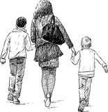 Mother with her sons on a walk Stock Photography