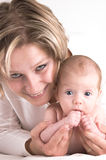 Mother and her sucking baby royalty free stock image