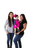 A mother with her teenage daughter and baby daughter Stock Photo