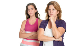 Mother and her teenage daughter sad and angry at each other Royalty Free Stock Images