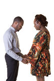 A mother and her teenage son bowing to pray Stock Photography