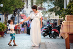 Mother and her three years old son walking in city Royalty Free Stock Photography