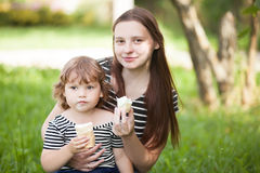 Mother and her toddler daughter with icecream Royalty Free Stock Images