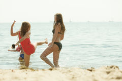 Mother and her toddler daughter playing on beach Stock Photography