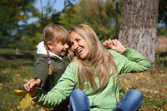 Mother and her toddler girl in autumn fields Stock Image