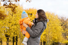 Mother and her toddler son playing in the park Stock Photography