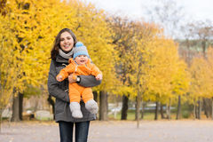 Mother and her toddler son playing in the park Stock Photo