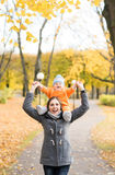 Mother and her toddler son playing in the park. Autumn nature background. Love and family concept Royalty Free Stock Images