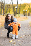 Mother and her toddler son playing in the park Royalty Free Stock Image