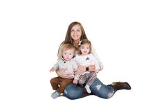 A mother and her twin babies Stock Images