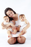 Mother with her twins Stock Photography