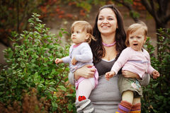 Mother with her twins Royalty Free Stock Image