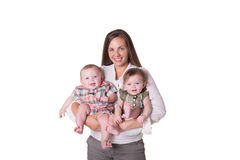 A mother and her twins. A mother and her fraternal boy/girl twins isolated royalty free stock image