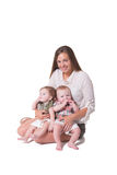 A mother and her twins. A mother and her fraternal boy/girl twins isolated stock photos