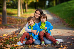 Mother with her two boys in the park Stock Images