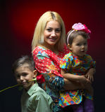 Mother with her two children  Stock Images