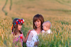 Mother and her two daughters Stock Images