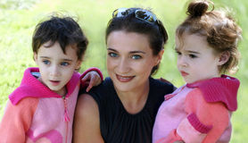 Mother and her two daughters. An outdoor portrait of a mother and her two daughters Stock Photos