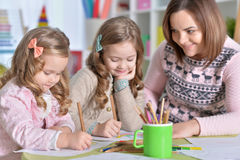 Mother and her two daughters drawing Stock Photo