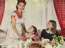 Mother with her two daughters have breakfast Royalty Free Stock Photography