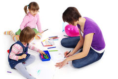 Mother and her two daughters painting Stock Photography