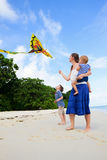 Mother and her two kids flying kite Stock Image