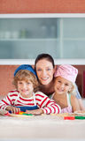 Mother with her Two Kids in the kitchen Royalty Free Stock Photography