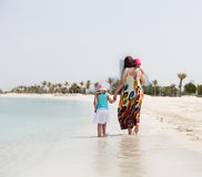 Mother and her two little daughters on the beach Stock Photography