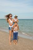 Mother and her two sons having fun on the beach Royalty Free Stock Image