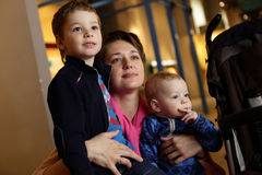 Mother and her two sons in museum Royalty Free Stock Photo