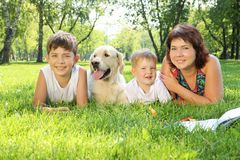 Mother and her two sons in the park with a dog Royalty Free Stock Photography