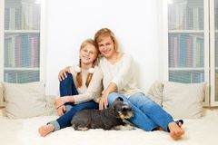 Mother with her 10 years old kid girl sitting home, casual lifestyle photo series. Cozy homely scene royalty free stock images