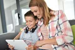 Mother and her young boy using tablet Stock Images