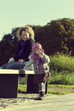 Mother with her young daughter at the park Stock Photography