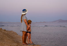 Mother with her young son on a sunset beach Royalty Free Stock Photography