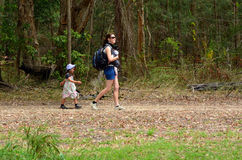 Mother hike with her infant baby and child stock images