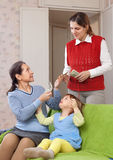 Mother hires governess Stock Photo