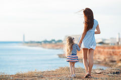 Mother and his adorable little daughter at beach Stock Photo