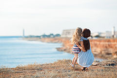 Mother and his adorable little daughter at beach stock image
