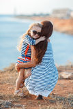 Mother and his adorable little daughter at beach Stock Photography