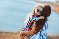 Mother and his adorable little daughter at beach Royalty Free Stock Photo