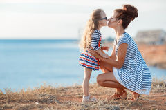 Mother and his adorable little daughter at beach Royalty Free Stock Images